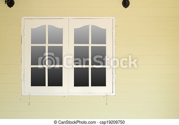 wooden window on wooden wall - csp19209750
