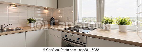 Wooden worktops and white cupboards - csp28116982