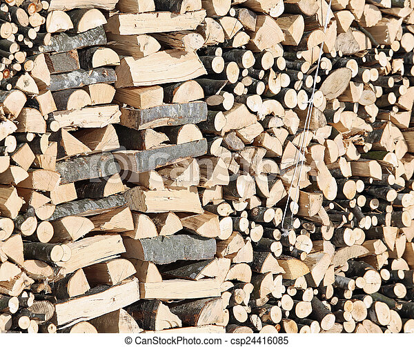 Woodshed with pieces of wood cut for the stove - csp24416085