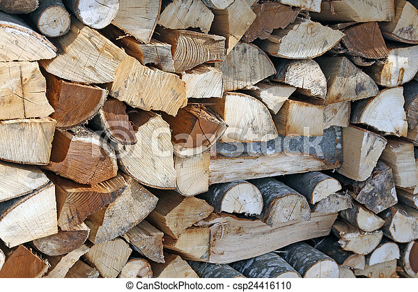 Woodshed with pieces of wood cut - csp24416110