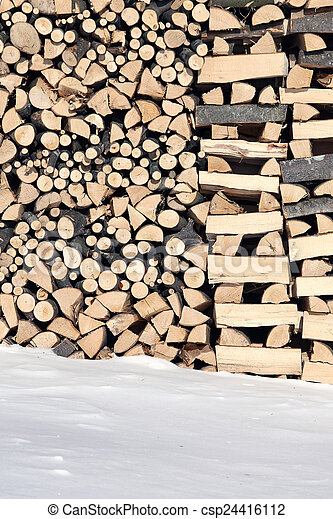 Woodshed with pieces of wood piled for winter - csp24416112