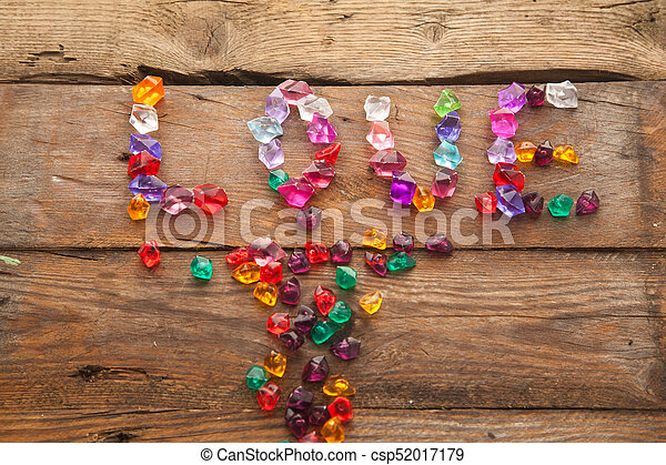 "Word ""love"" written with colorful stones. - csp52017179"