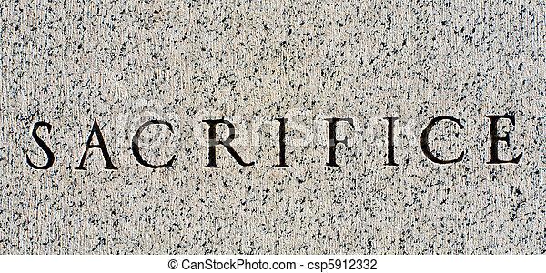 "Word ""Sacrifice"" Carved in Gray Granite Stone - csp5912332"
