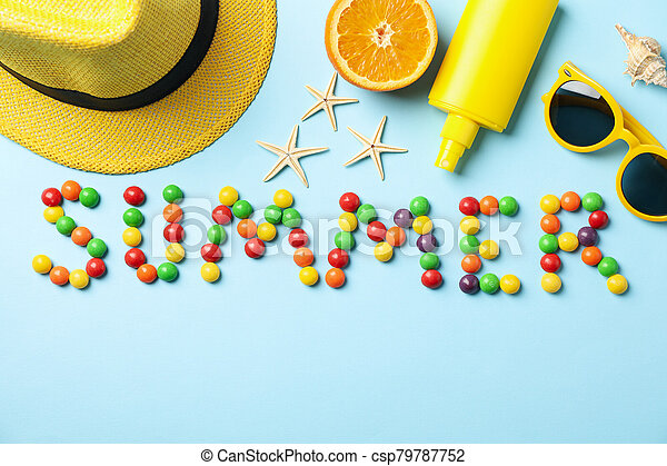 Word Summer and vacation accessories on blue background, top view - csp79787752