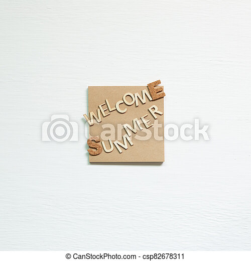 Word 'Welcome summer' on memo pad on white background. Summer vacation concept. top view - csp82678311