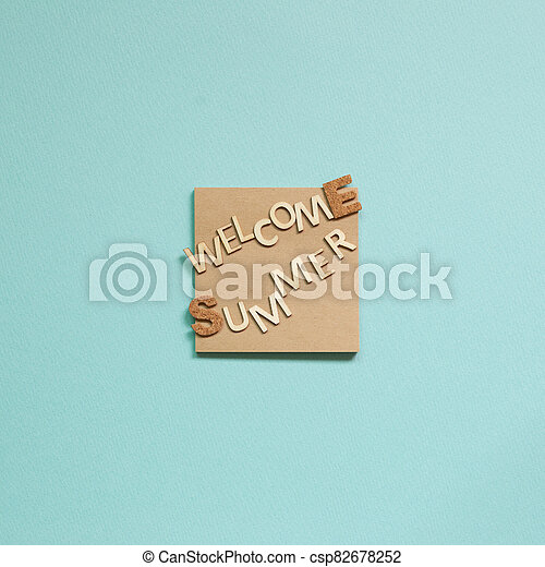 Word 'Welcome summer' on memo pad on blue background. Summer vacation concept. top view - csp82678252