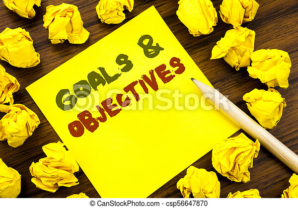 Word, writing Goals Objectives. Business concept for Plan Success Vision Written on sticky note paper, wooden background with folded yellow paper meaning thinking - csp56647870