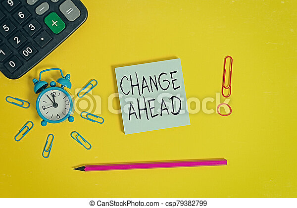 Word writing text Change Ahead. Business concept for to replace with or exchange for another Become different Alarm clock calculator clips rubber band pencil notepad colored background. - csp79382799