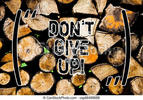 Word writing text Don T Give Up. Business concept for Keep trying until you succeed follow your dreams goals Wooden background vintage wood wild message ideas intentions thoughts. - csp66499688