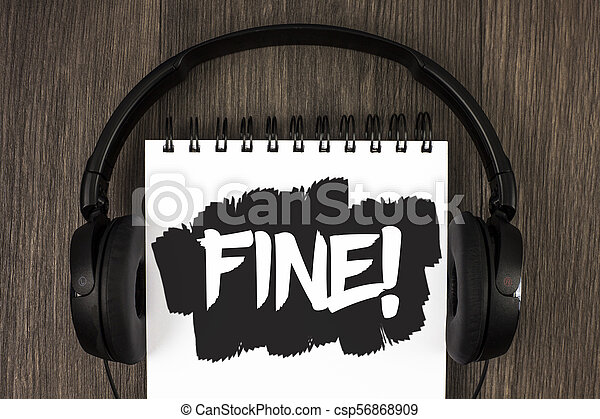 Word writing text Fine Motivational Call. Business concept for No hidden charges from large moving companies written on Notepad on the wooden background Headphone next to it. - csp56868909