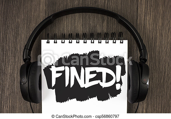 Word writing text Fined Motivational Call. Business concept for No penalty charge for late credit card bill payment written on Notepad on the wooden background Headphone next to it. - csp56860797