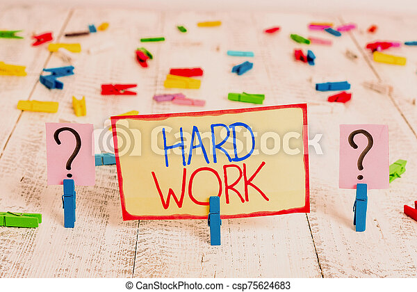 Word writing text Hard Work. Business concept for always putting a lot of effort and care into work or endurance Scribbled and crumbling sheet with paper clips placed on the wooden table. - csp75624683