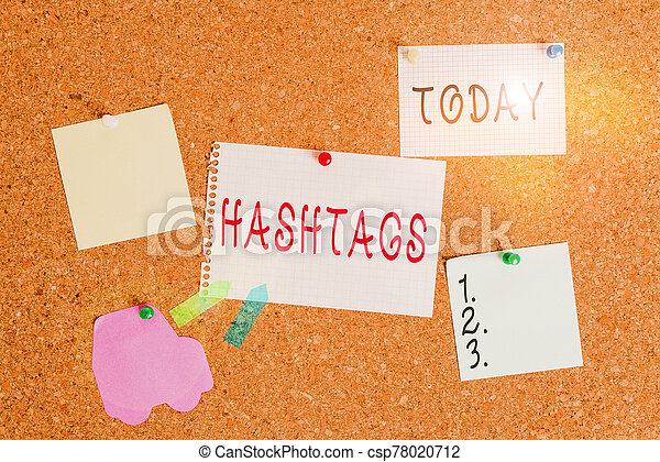 Word writing text Hashtags. Business concept for a word or phrase preceded by a hash sign Type of metadata tag Corkboard color size paper pin thumbtack tack sheet billboard notice board. - csp78020712