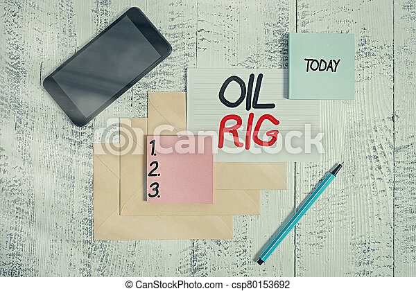 Word writing text Oil Rig. Business concept for large structure with equipment to remove oil from under the seabed Envelopes marker ruled paper smartphone sheet note pads wooden background. - csp80153692