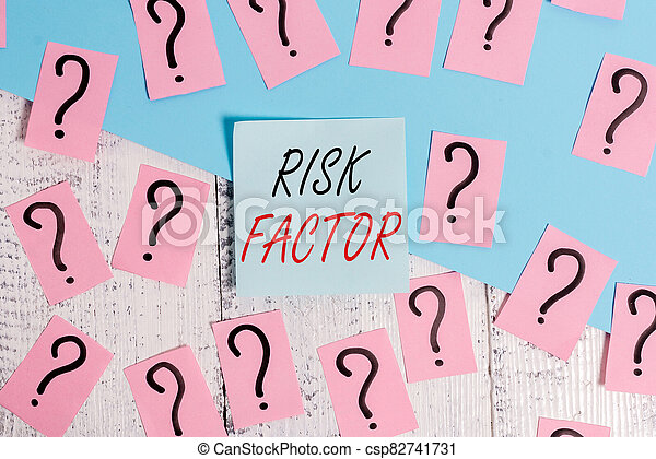 Word writing text Risk Factor. Business concept for Characteristic that may increase the percentage of acquiring a disease Scribbled and crumbling papers with thick cardboard above wooden table. - csp82741731