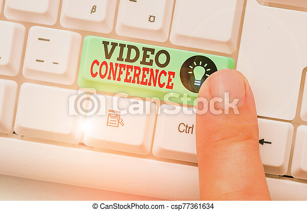 Word writing text Video Conference. Business concept for showing in remote places hold facetoface meetings. - csp77361634