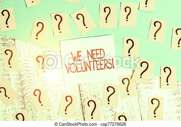 Word writing text We Need Volunteers. Business concept for someone who does work without being paid for it Scribbled and crumbling papers with thick cardboard above wooden table. - csp77276626