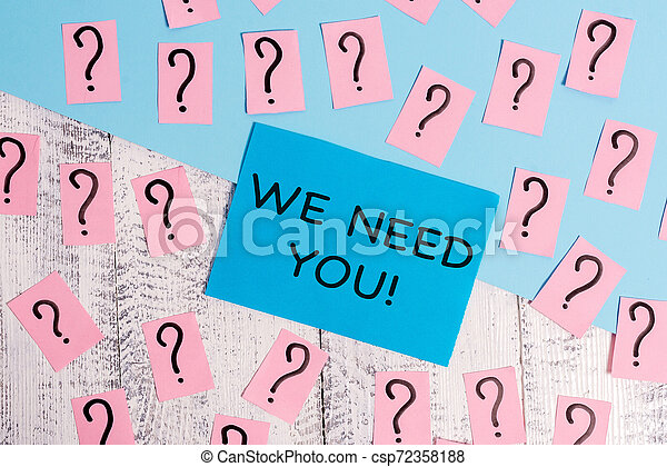 Word writing text We Need You. Business concept for asking someone to work together for certain job or target Scribbled and crumbling papers with thick cardboard above wooden table. - csp72358188