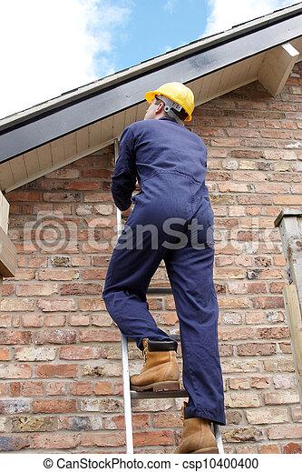 Work man climbing a ladder  - csp10400400