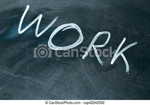 WORK phrase written in chalk on the blackboard. - csp42242592