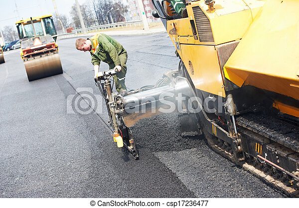 worker at asphalting works - csp17236477