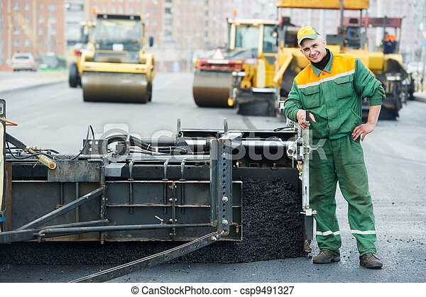worker at asphalting works - csp9491327