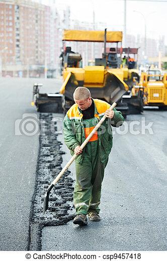 worker at asphalting works - csp9457418