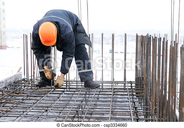 worker at construction site making carcass - csp3334660