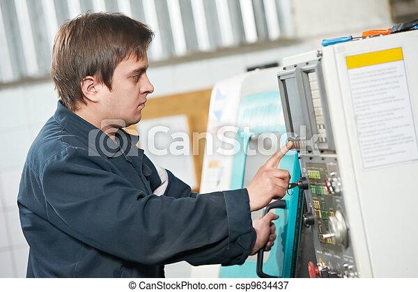 worker at tool workshop - csp9634437