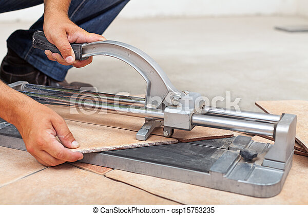Worker Cutting Floor Tiles With Manual Cutter Closeup
