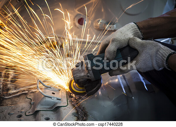 worker hand working by industry tool cutting steel with split fire use for industrial manufacturing theme - csp17440228