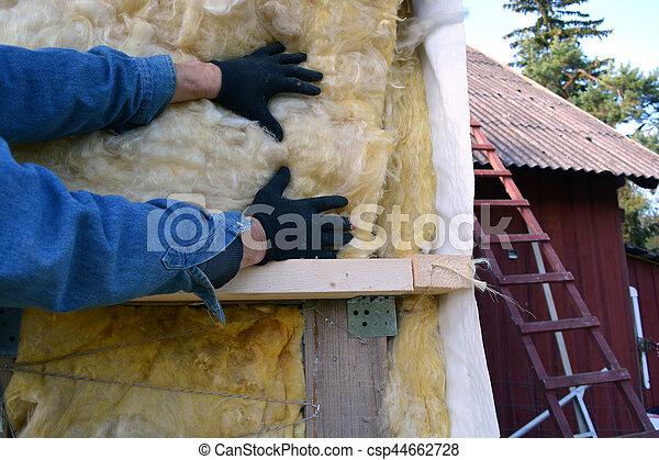 worker hands on house  insulatiom material rockwool - csp44662728
