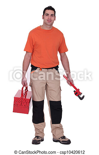 Worker holding a pipe wrench and toolbox - csp10420612