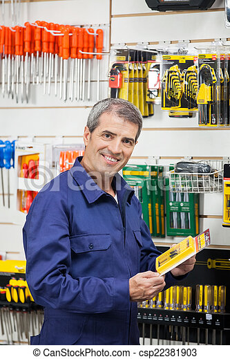 Worker Holding Tool Package In Hardware Shop - csp22381903
