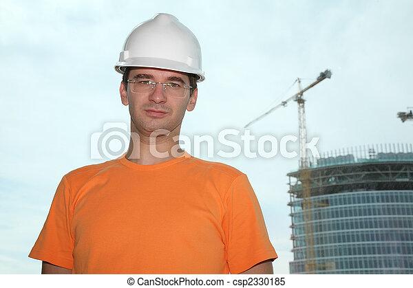 worker in the helmet - csp2330185