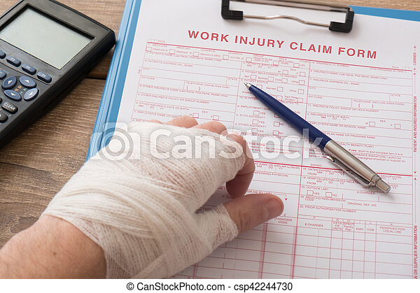 Worker injured hand filling a insurance claim form - csp42244730