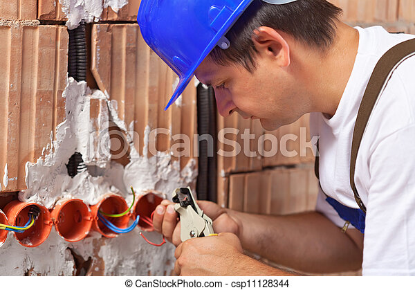 worker installing electrical wires in building wall worker rh canstockphoto com