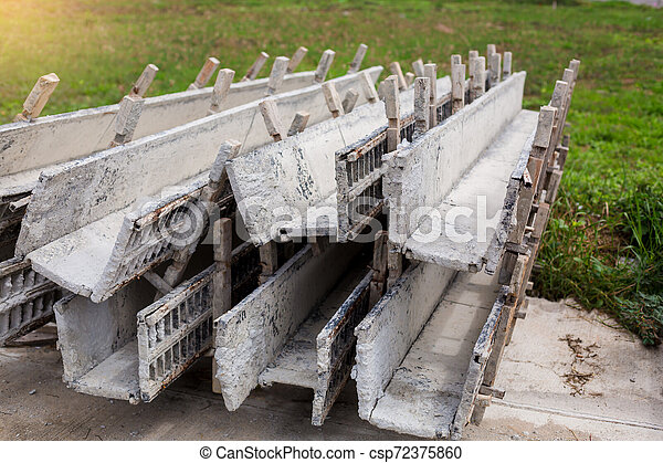 worker make wood formwork in site constroction ,workers column box preparation for cement in Home construction. - csp72375860