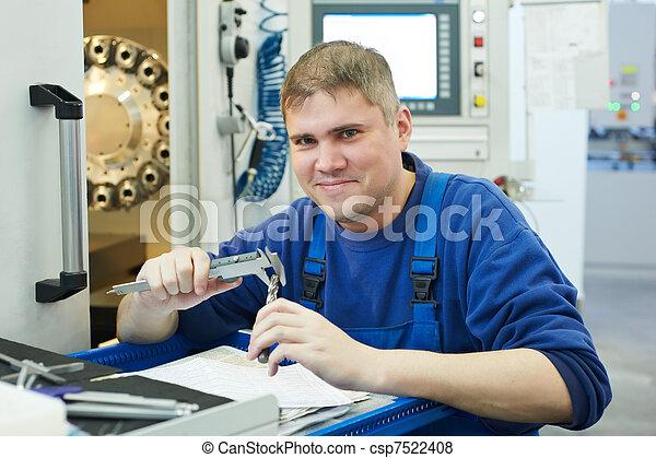 worker measuring detail - csp7522408