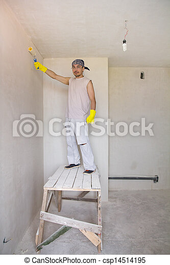 Worker painting wall with painting roller - csp14514195