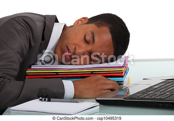 Worker sleeping on a stack of folders - csp10495319