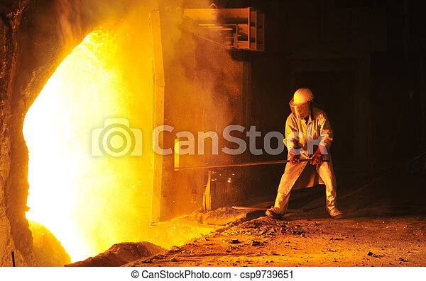 worker takes a sample at steel company  - csp9739651