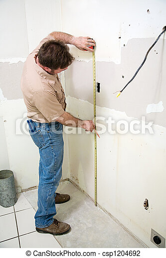 Worker Taking Measurement - csp1204692
