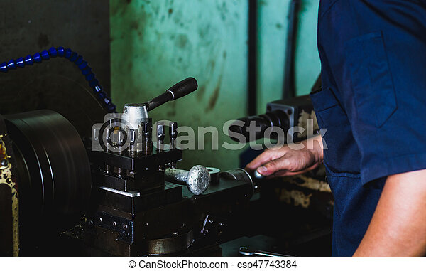 worker use lathe machine to product in workshop - csp47743384