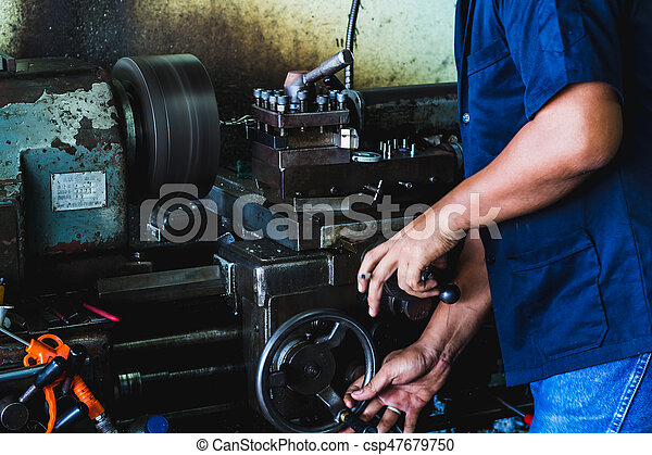 worker use lathe machine to product in workshop - csp47679750