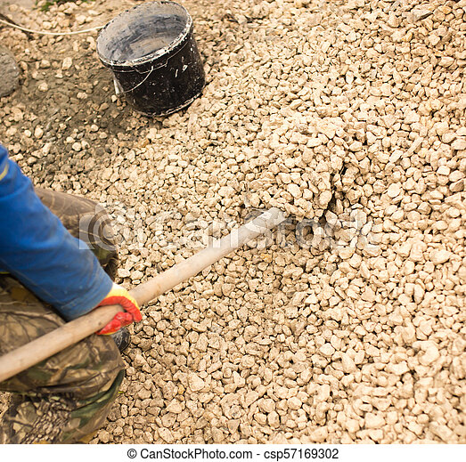 worker with a shovel at the construction site - csp57169302