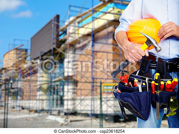 Worker with a tool belt. - csp23618254