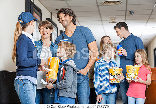 Worker With Families At Cinema - csp24783779