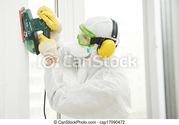 worker with sander at wall filling - csp17090472