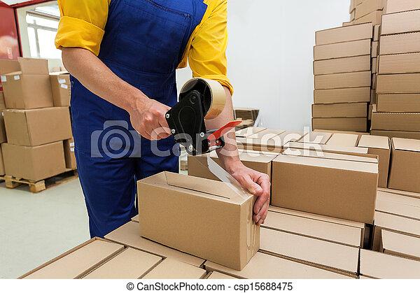 Worker with tape gun - csp15688475